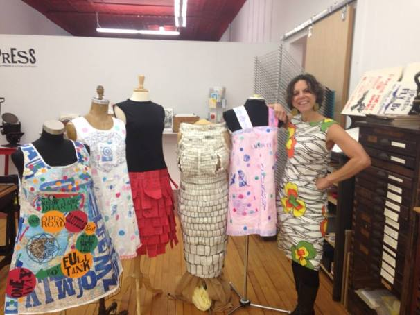 Dresses L to R: Karen Arp-Sandel, Diane Sullivan, Melanie Mowinski, Adrienne Gale, Diane Sullivan and PRESS founder and organizer of Paper Dresses Melanie Mowinski fits right in...