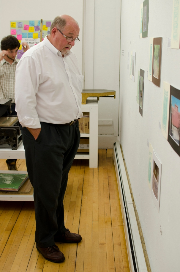Mayor Alcombright enjoys the student photographs