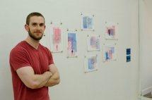 The artist poses in front of his prints!
